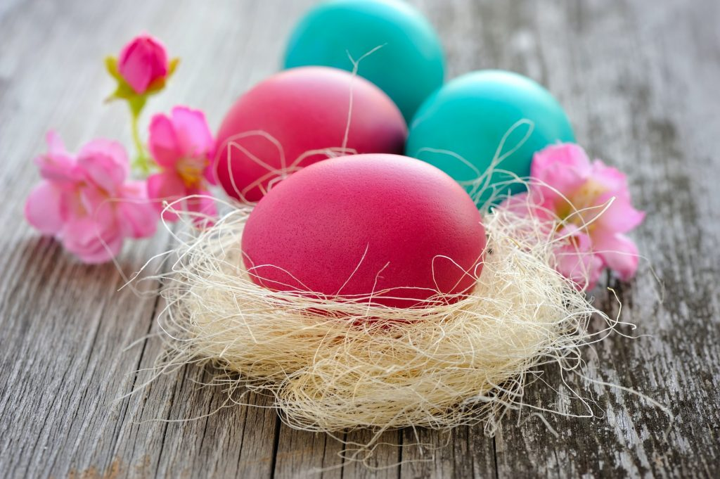 Colorful easter eggs on old wooden table